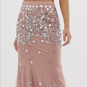 A nude color skirt with sequin detailing